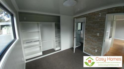 Master bedroom showing wardrobe (open)