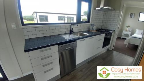 Kitchen bench with dishwasher and oven